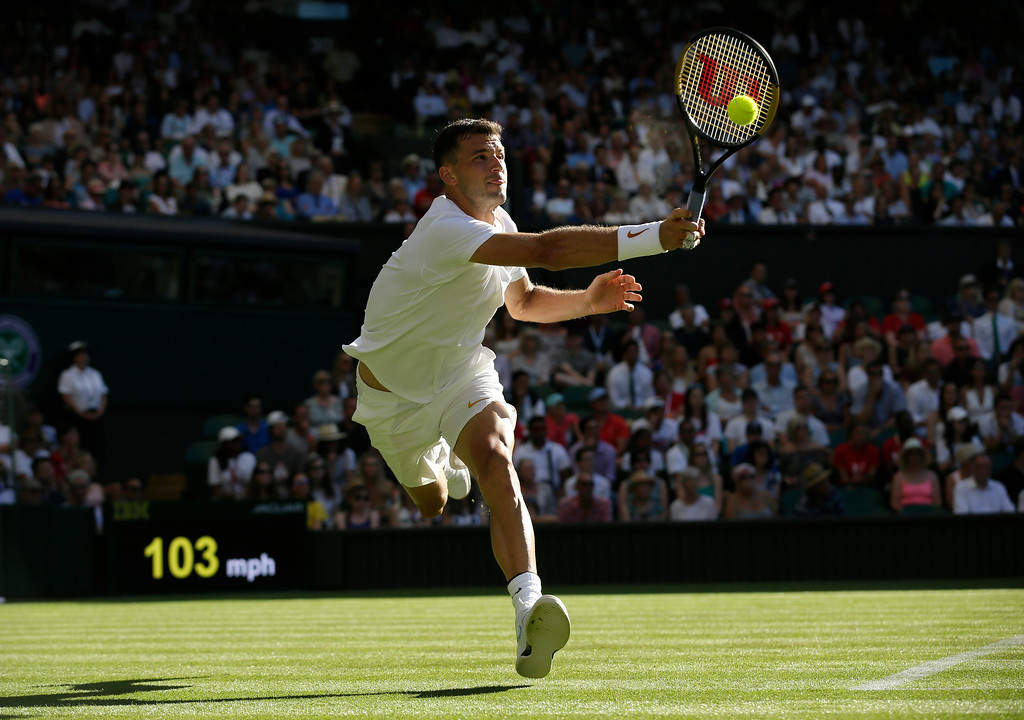 . Grigor Dimitrov of Bulgaria, returns to Switzerland\'s Stan Wawrinka, during the Men\'s Singles first round match at the Wimbledon Tennis Championships in London, Monday July 2, 2018. (AP Photo/Tim Ireland)