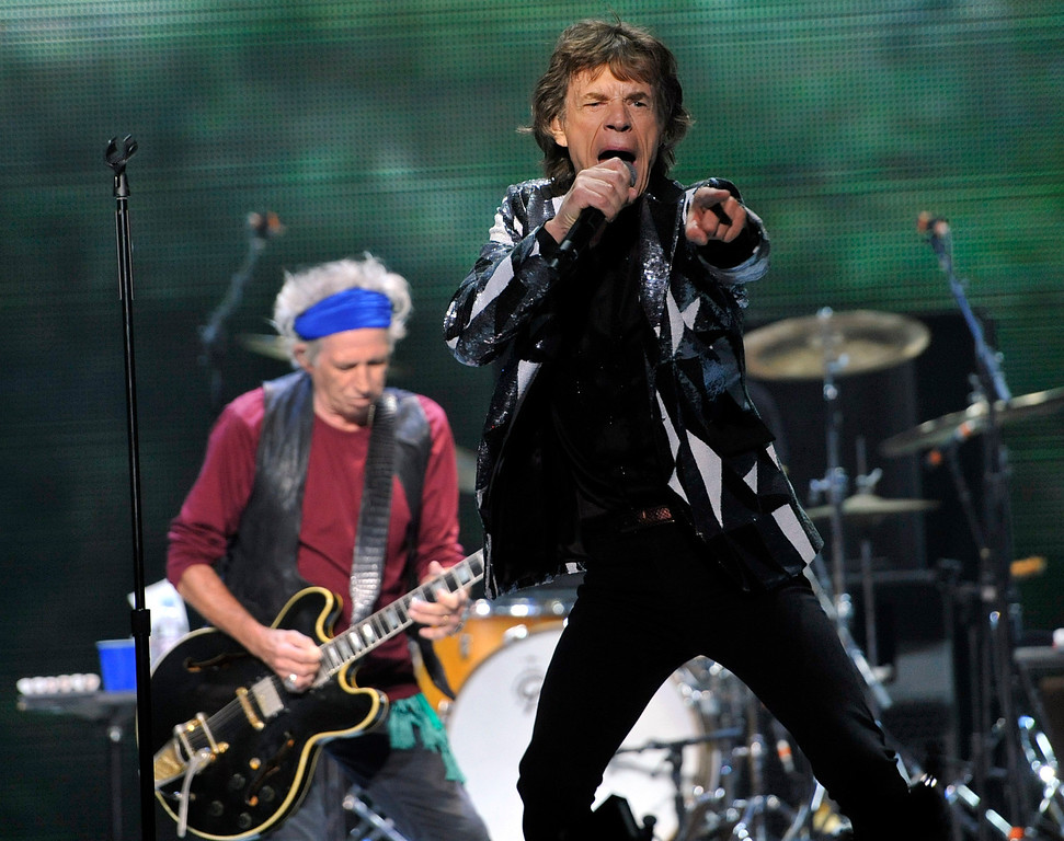 ". Mick Jagger, right, and Keith Richards of the Rolling Stones perform at the kick-off of the band\'s ""50 and Counting\"" tour at the Staples Center on Friday, May 3, 2013 in Los Angeles. (Photo by Chris Pizzello/Invision/AP)"