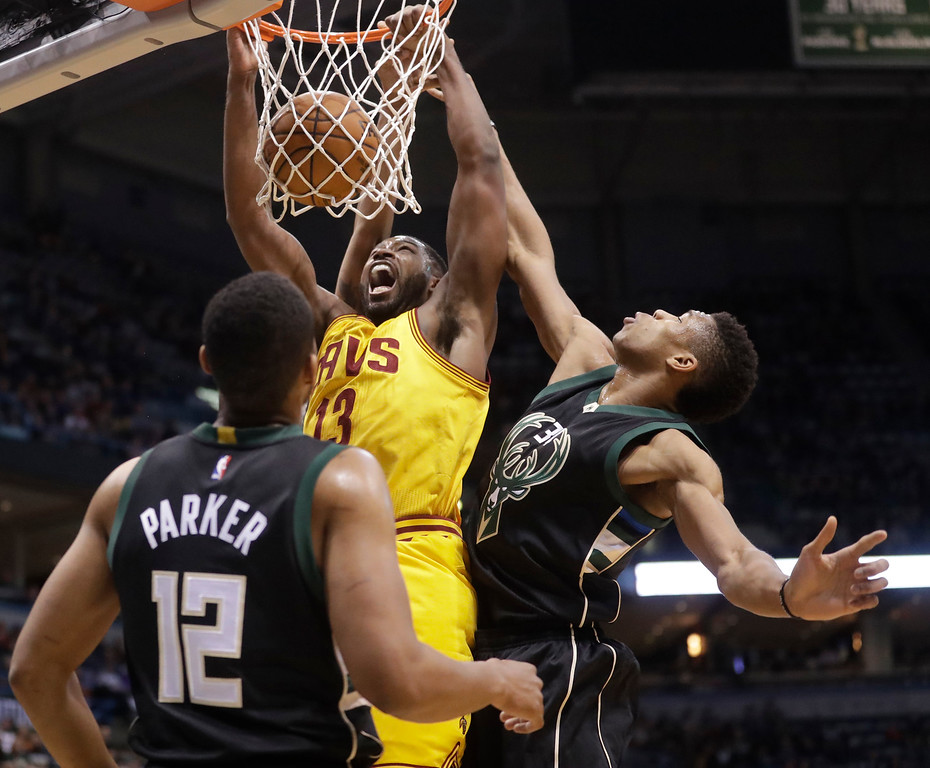. Cleveland Cavaliers\' Tristan Thompson dunks past Milwaukee Bucks\' Giannis Antetokounmpo during the first half of an NBA basketball game Tuesday, Dec. 20, 2016, in Milwaukee. (AP Photo/Morry Gash)