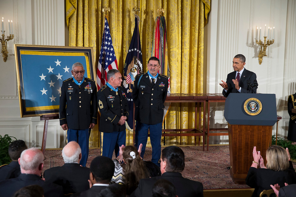 . President Barack Obama applauds, from left, Staff Sgt. Melvin Morris, Sgt. 1st Class Jose Rodela, and Spc. Santiago J. Erevia after the president awarded them the Medal of Honor during a ceremony in the East Room of the White House in Washington, Tuesday, March 18, 2014.  (AP Photo/ Evan Vucci)