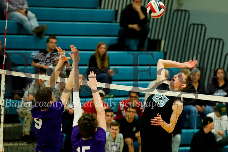 Luke Trzeciak goes for a spike in the playoff win over Baldwin. Seb Foltz/Butler Eagle