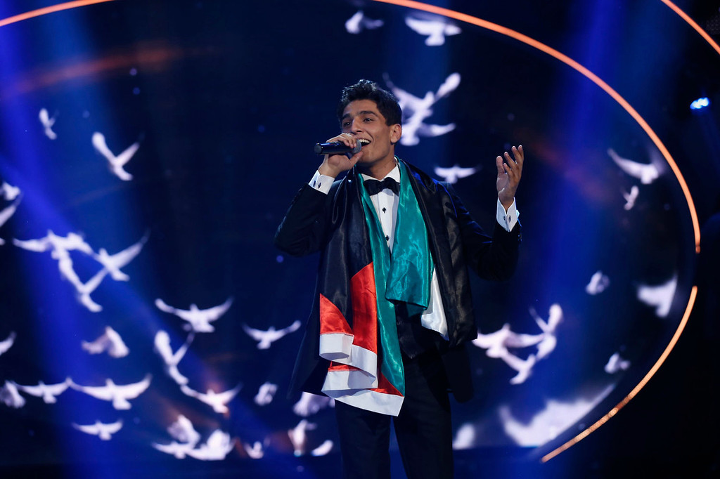 ". Palestinian singer Mohammed Assaf performs after being announced the winner during the Season 2 finale of ""Arab Idol\"" in Zouk Mosbeh area, north of Beirut on June 22, 2013. REUTERS/Mohammed Azakir"