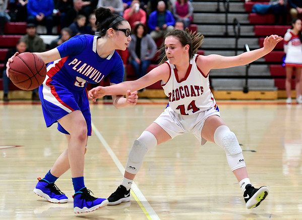 2/26/2019 Mike Orazzi   Staff Plainvilles Jaida Vasquez (5) and Berlin's Angela Perrelli (14) during the CIAC 2019 State Girls Basketball Tournament at Berlin High School Tuesday night.