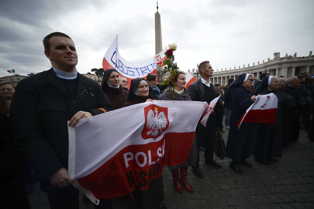 . Polish faithfuls attend Pope\'s first Angelus prayer at St Peter\'s square on March 17, 2013 at the Vatican. Pope Francis begins his papacy in earnest today ahead of his formal inauguration mass, with a weekly prayer address used by previous pontiffs to comment on international affairs. The pope\'s first Angelus prayer, delivered from a window high above St Peter\'s Square, is a chance for the first Latin American pontiff to begin to sketch out a more global vision for the role of the Roman Catholic Church.   FILIPPO MONTEFORTE/AFP/Getty Images