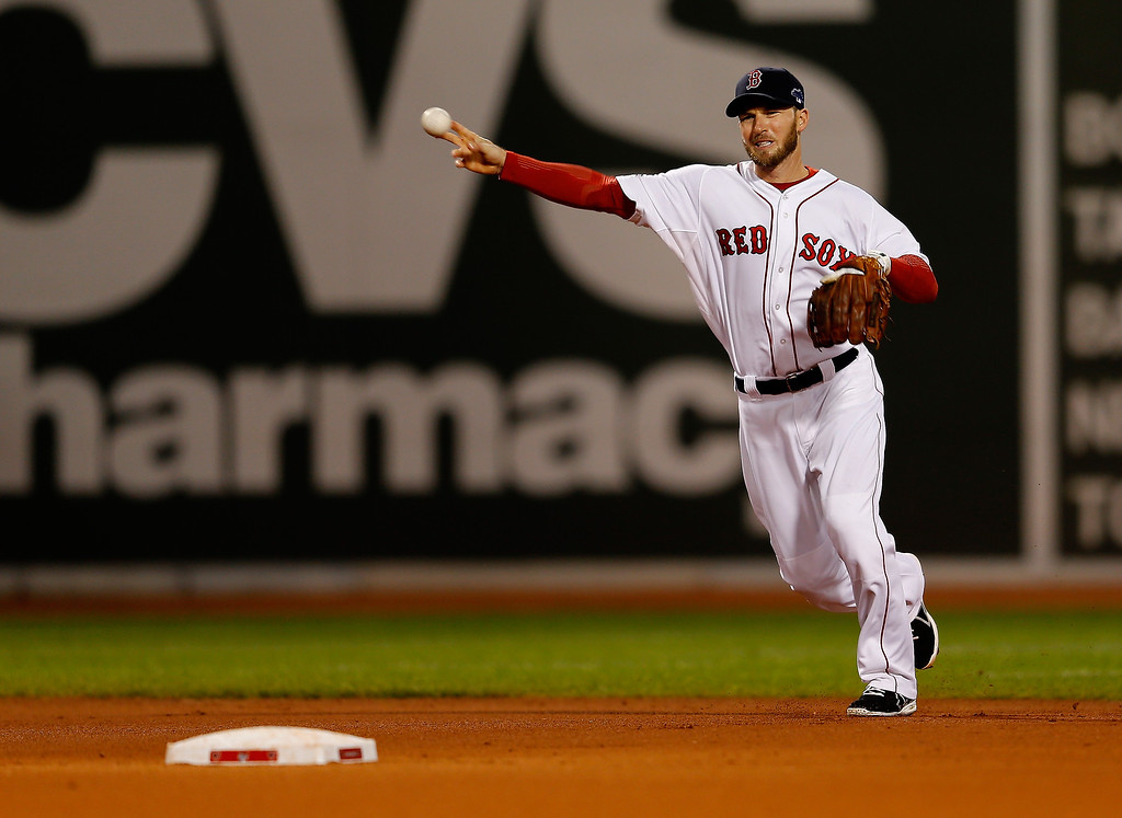 . Stephen Drew #7 of the Boston Red Sox throws to first base for an out in the first inning against the Detroit Tigers during Game Two of the American League Championship Series at Fenway Park on October 13, 2013 in Boston, Massachusetts.  (Photo by Jim Rogash/Getty Images)