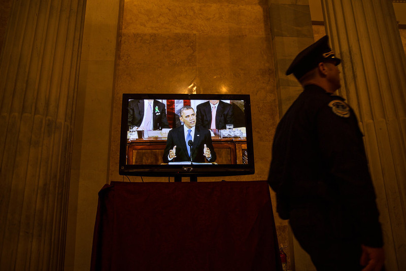 . U.S. President Barack Obama is seen on a television screen in a hallway in the U.S. Capitol as he delivers his State of the Union Address February 12, 2013 in Washington, D.C. Facing a divided Congress, Obama focused his speech on new initiatives designed to stimulate the U.S. economy. (Photo by Drew Angerer-Pool/Getty Images)