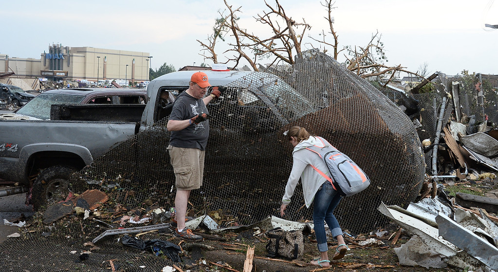 . A man tries to save his truck from the all the damage from a tornado. 