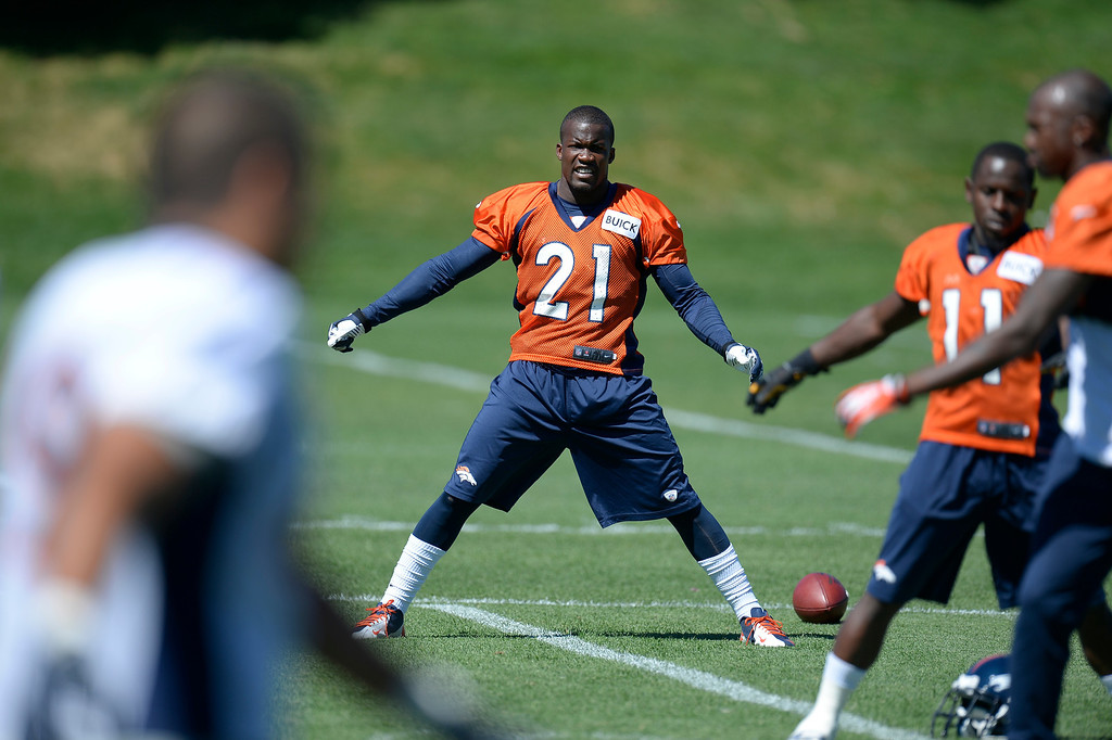 . Denver Broncos running back Ronnie Hillman (21) stretches before practice  August 26, 2013 at Dove Valley. (Photo by John Leyba/The Denver Post)