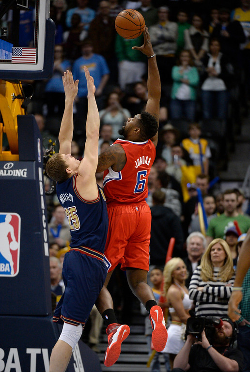 . Los Angeles Clippers center DeAndre Jordan (6) takes a shot over Denver Nuggets center Timofey Mozgov (25) during the first quarter. (Photo by John Leyba/The Denver Post)