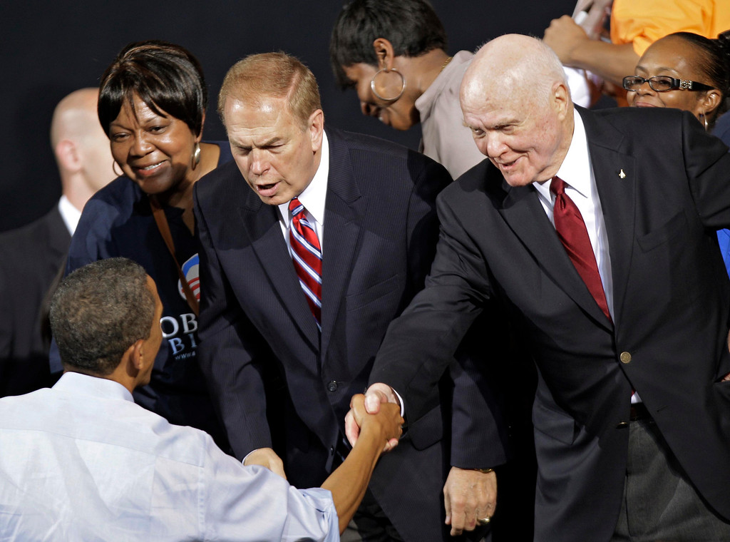 . Former Sen. John Glenn, right, and former Ohio Gov. Ted Strickland congratulate President Barack Obama after his campaign rally at The Ohio State University in Columbus, Ohio, Saturday, May 5, 2012. (AP Photo/Mark Duncan)