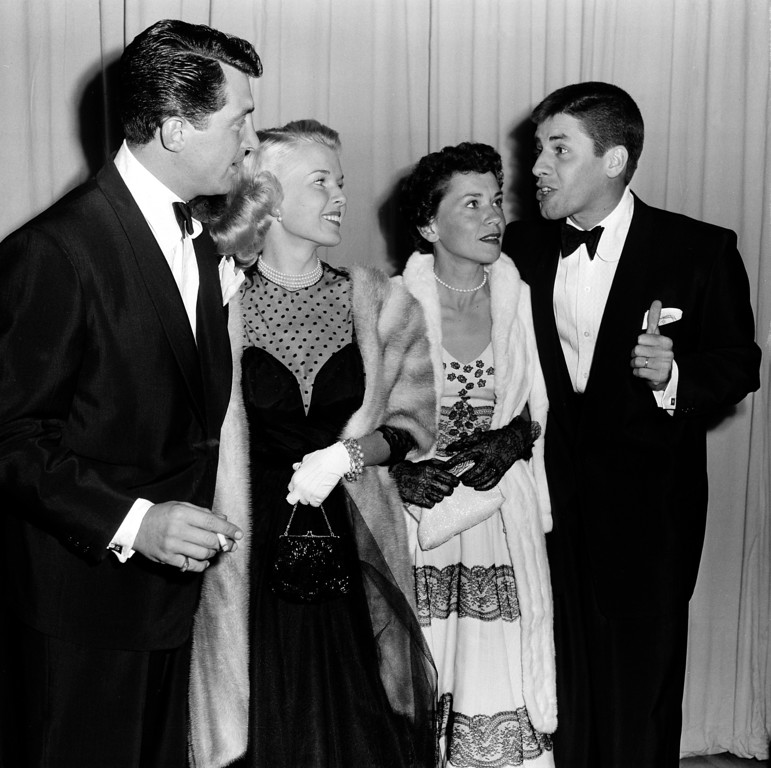 . Actor-comedian Dean Martin, left, and  his wife, Jeanne, are shown with actor-comedian Jerry Lewis, far right, and his wife, singer Patti, as they arrive at the Academy Awards presentations at the RKO Pantages Theatre in Los Angeles, Ca., March 29, 1951.  (AP Photo)