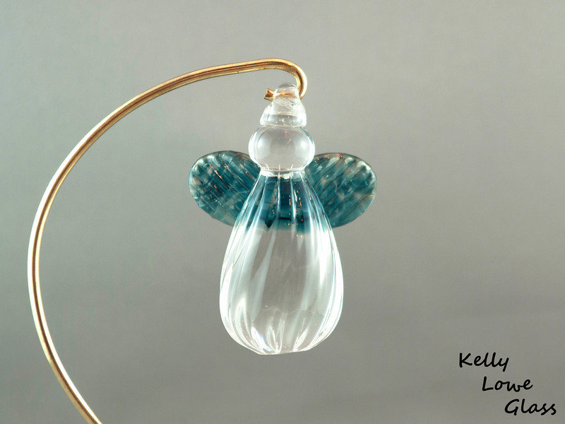"""Hanging Glass Angel:  What could you do if you were a hand sculpted hanging glass angel? What couldn't you do! You could be the champion of a Christmas Tree, for one, or hang in a window to catch all the sunlight (the solar ray kind, not the dishsoap kind) and just shine and twinkle the day away. You'd make a pretty nifty gift, and you'd be tasty on... well, nothing actually - you are made of solid glass after all. Also you'd be all full of hand sculpted goodness that makes you special, interesting, and better than those mass manufactured stuff. Oh that's right, you could look down your nose... or... front of your spherical head I guess, at those not handmade and say """"blargh."""" And they'd know what that means, 'cause you're a great communicator.  Height: Approx 8cm (3.15"""") Across the Wings: Approx 5.5cm (2.17"""") Depth: Approx 3cm (1.19"""") Weight: Approx 85g (0.19 lbs)  If you're interested in seeing more pictures of this angel design with different wing colours, please click here.   (Link opens in a new window)  Click here to be taken to a gallery of all my various ornament types (Link opens in a new window)"""
