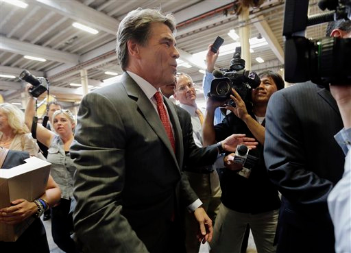 Description of . Texas Gov. Rick Perry leaves Holt Cat, Monday, July 8, 2013, in San Antonio after announcing he will not seek reelection. A staunch Christian conservative, proven job-creator and fierce defender of states' rights, Perry has been in office nearly 13 years, making him the nation's longest-sitting current governor. (AP Photo/Eric Gay)