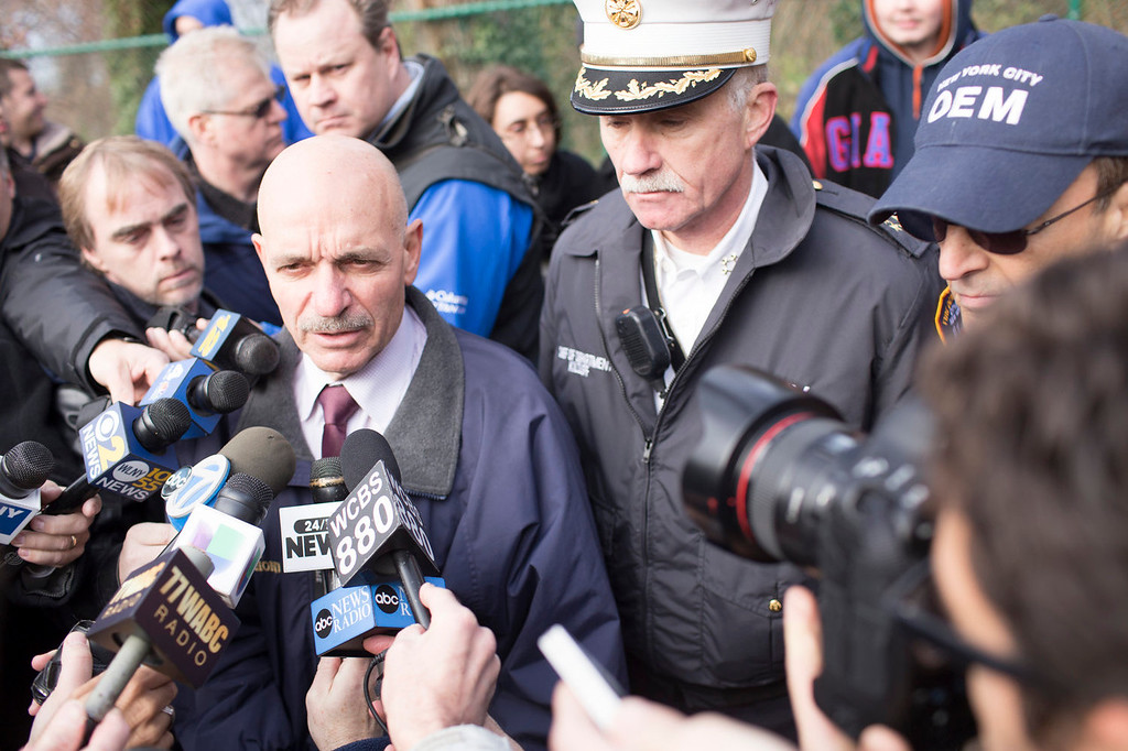 . Fire Department of New York (FDNY) Commissioner Salvatore Cassano (L) speaks to the media after Metro-North train derailed near the Spuyten Duyvil station December 1, 2013 in the Bronx borough of New York City. Multiple injuries and several deaths were reported after the seven car train left the tracks as it was heading to Grand Central Terminal along the Hudson River line.  (Photo by Christopher Gregory/Getty Images)