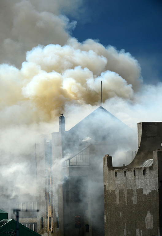 . Smoke rises into the sky after a fire broke out at the Glasgow School of Art Charles Rennie Mackintosh Building on May 23, 2014 in Glasgow, Scotland. (Photo by Jeff J Mitchell/Getty Images)