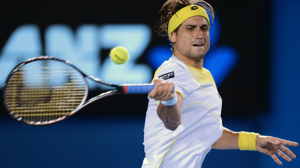 . Spain\'s David Ferrer plays a return during his men\'s singles semi-final match against Serbia\'s Novak Djokovic on the eleventh day of the Australian Open tennis tournament in Melbourne on January 24, 2013.   GREG WOOD/AFP/Getty Images