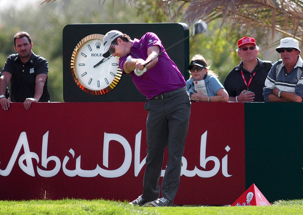 Description of . Justin Rose of England tees off on the 8th hole during the first round of Abu Dhabi Golf Championship in Abu Dhabi, United Arab Emirates, Thursday, Jan. 17, 2013. (AP Photo/Manuel Salazar)
