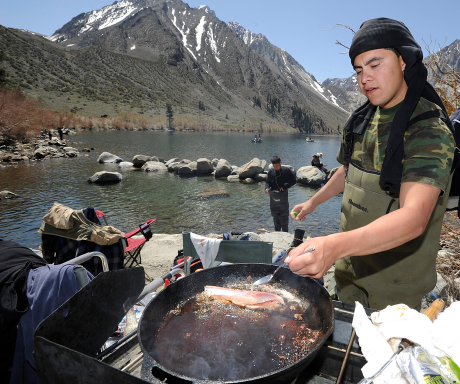 . Derrick Perez, of Upland, cooks some trout that he just pulled out of Convict Lake on opening day of Trout Fishing Season in the Eastern Sierra. Convict Lake, CA 4/27/2013(John McCoy/Staff Photographer)