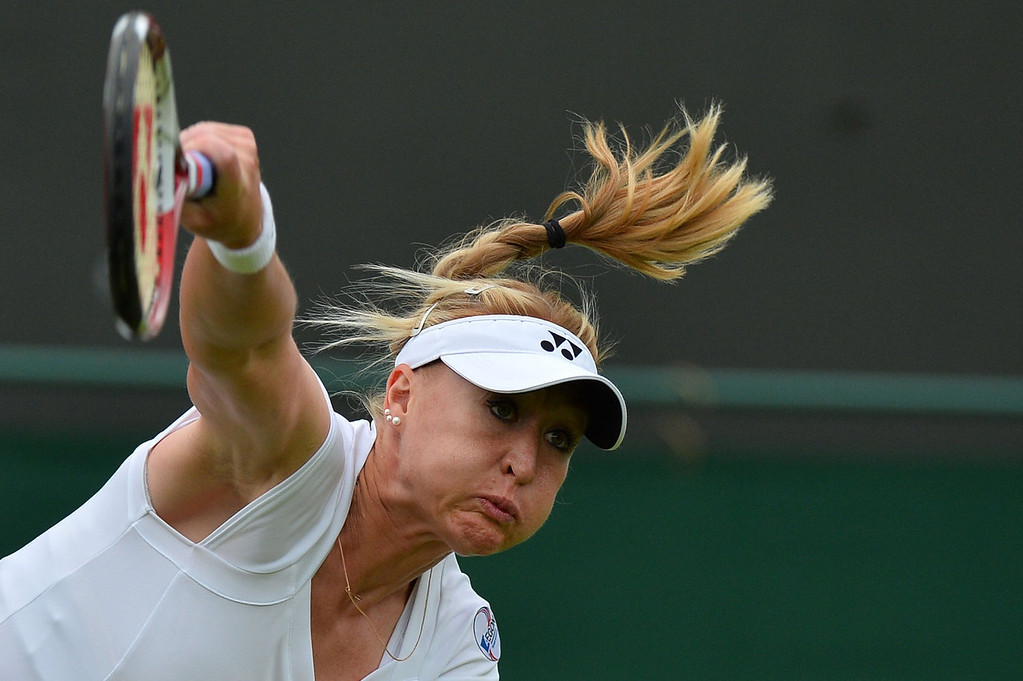 . Britain\'s Elena Baltacha serves against Italy\'s Flavia Pennetta during their first round match on day one of the 2013 Wimbledon Championships tennis tournament at the All England Club in Wimbledon, southwest London, on June 24, 2013.  BEN STANSALL/AFP/Getty Images