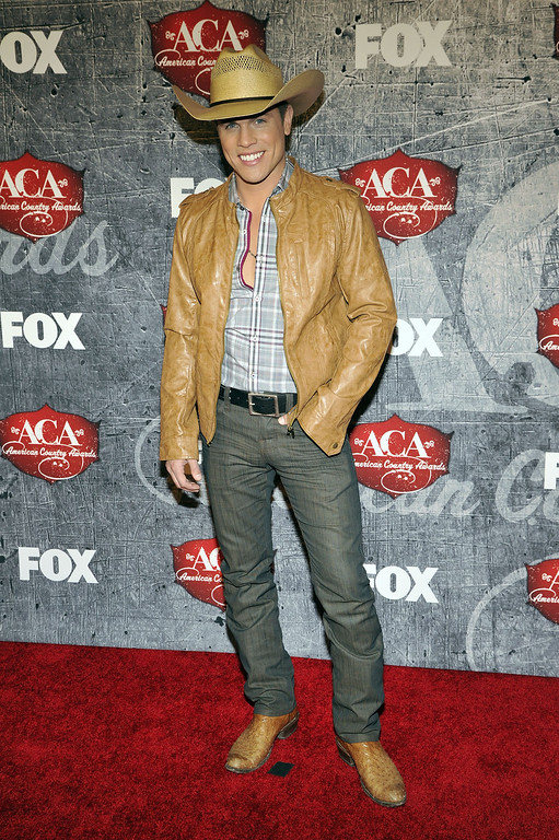. Singer Dustin Lynch arrives at the American Country Awards on Monday, Dec. 10, 2012, in Las Vegas. (Photo by Jeff Bottari/Invision/AP)