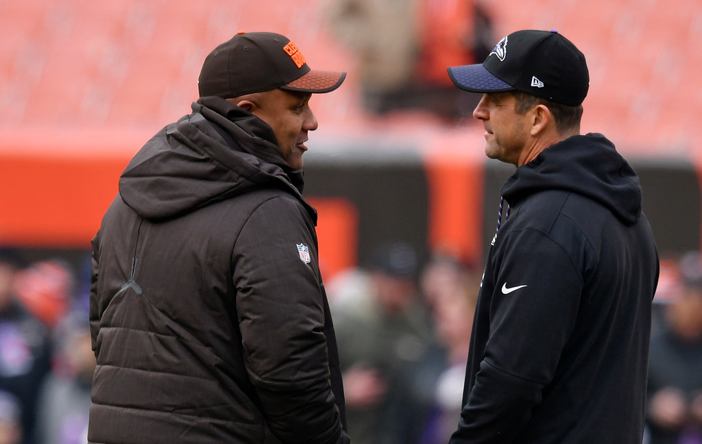 . Cleveland Browns head coach Hue Jackson, left, talks with Baltimore Ravens head coach John Harbaugh before an NFL football game between the Baltimore Ravens and the Cleveland Browns, Sunday, Dec. 17, 2017, in Cleveland. (AP Photo/David Richard)