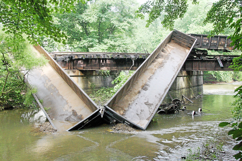 . Two cars go off a bridge into the Brandywine Creek following a train derailment in Valley, Chester County, on Monday, July 8, 2013.