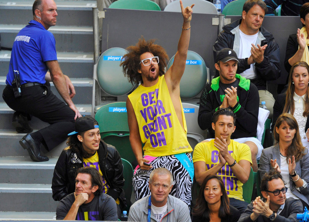 . LMFAO musician Redfoo (C), boyfriend of Victoria Azarenka of Belarus, gestures during her women\'s singles final match against Li Na of China at the Australian Open tennis tournament in Melbourne January 26, 2013. REUTERS/Toby Melville