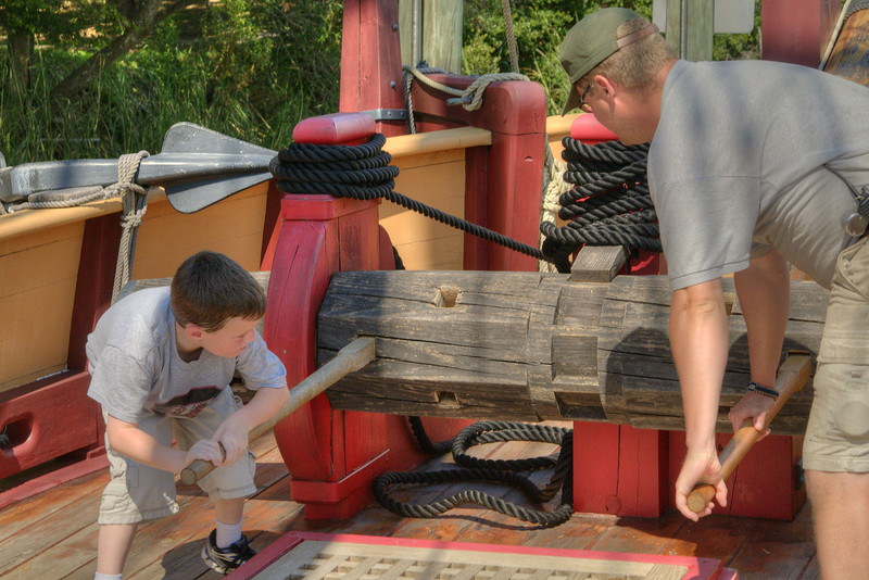 """A young boy assists a park ranger with """"raising"""" the anchor on the deck of The Adventure, a fully-functional replica of a 17th-century trading vessel, at Charles Towne Landing State Historic Park in Charleston, SC on Saturday, September 7, 2013. Copyright 2013 Jason Barnette"""