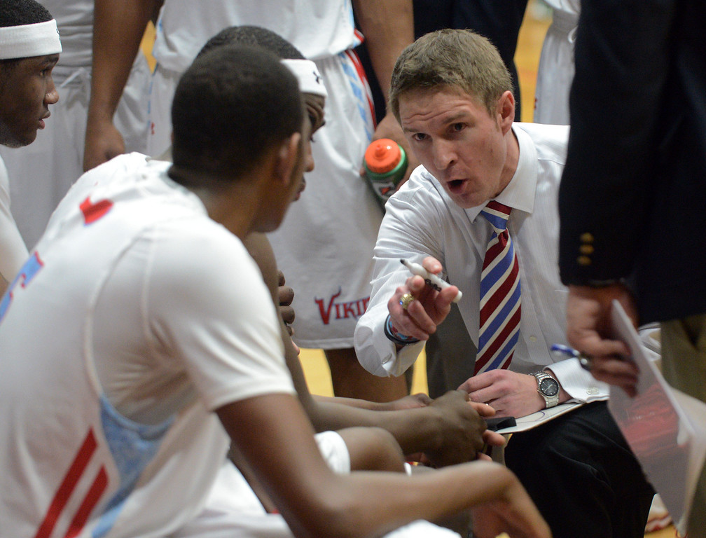 . Duncan Scott/DScott@News-Herald.com VASJ coach Babe Kwasniak talks to his team during a fourth quarter timeout. VASJ defeated Youngstown Ursuline 69-60 March 15 in the Division III regional final at Canton Memorial Fieldhouse.