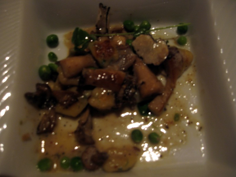 Third Course: Truffle Gnocchi with St. George's Mushrooms, English Peas, and Périgord Summer Black Truffles.  (I kept the camera flash off so as not to disturb other patrons, and I forgot to photograph the dish until I had eaten half of it.)