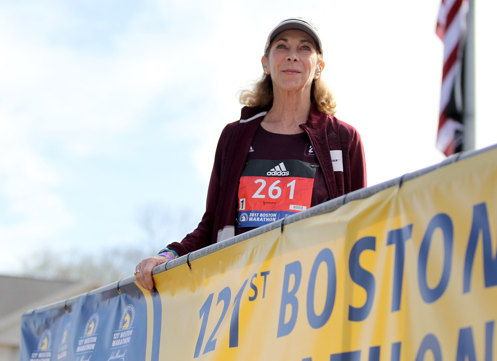 . Kathrine Switzer, who was the first official woman entrant in the Boston Marathon 50 years ago, smiles as she is introduced before firing the gun to start the women\'s elite division at the start of the 2017 Boston Marathon in Hopkinton, Mass., Monday, April 17, 2017. (AP Photo/Mary Schwalm)