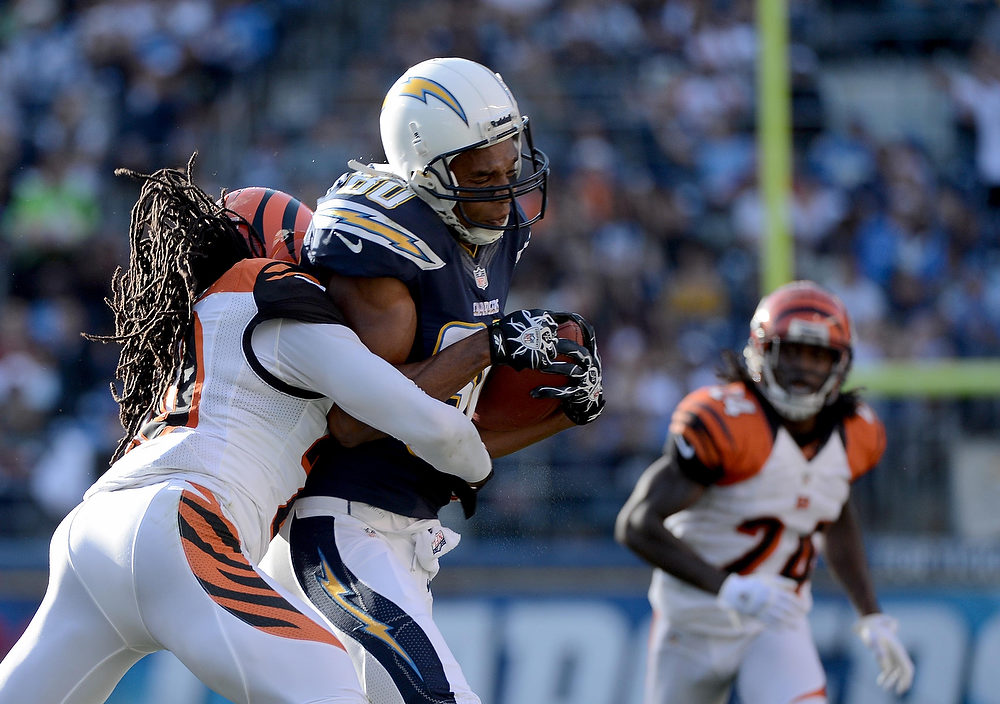 Description of . Malcom Floyd #80 of the San Diego Chargers gets tackled by Reggie Nelson #20 of the Cincinnati Bengals on December 2, 2012 at Qualcomm Stadium in San Diego, California. (Photo by Donald Miralle/Getty Images)