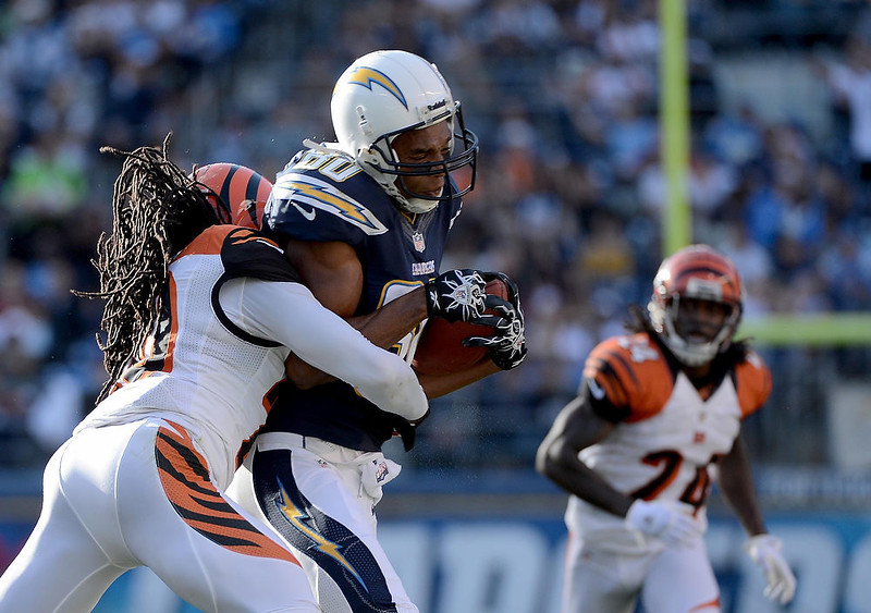 . Malcom Floyd #80 of the San Diego Chargers gets tackled by Reggie Nelson #20 of the Cincinnati Bengals on December 2, 2012 at Qualcomm Stadium in San Diego, California. (Photo by Donald Miralle/Getty Images)