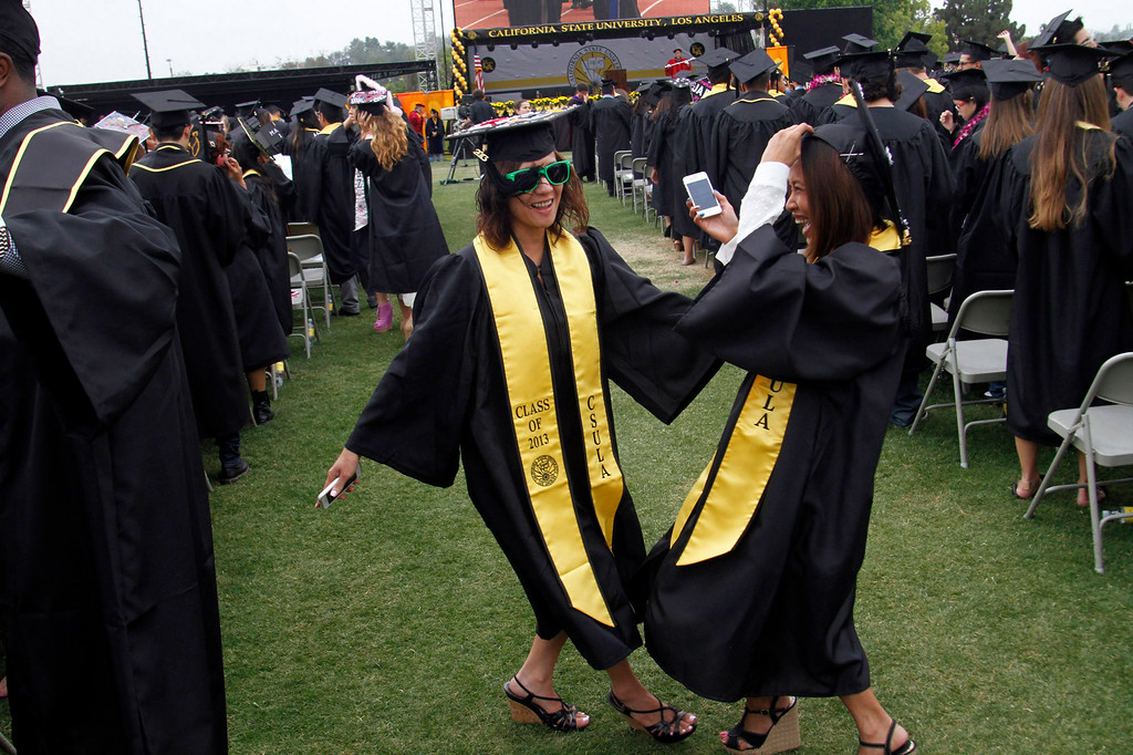 . Mae Dizon, left, and Sophea Nguon, both of Los Angeles, during the  California State University, Los Angeles, Sixty-Sixth Graduate and Undergraduate Commencement Ceremony, at California State University Athletic Stadium, in  Los Angeles, Saturday, June 15, 2013. (Correspondent Photo by James Carbone/SXCITY)