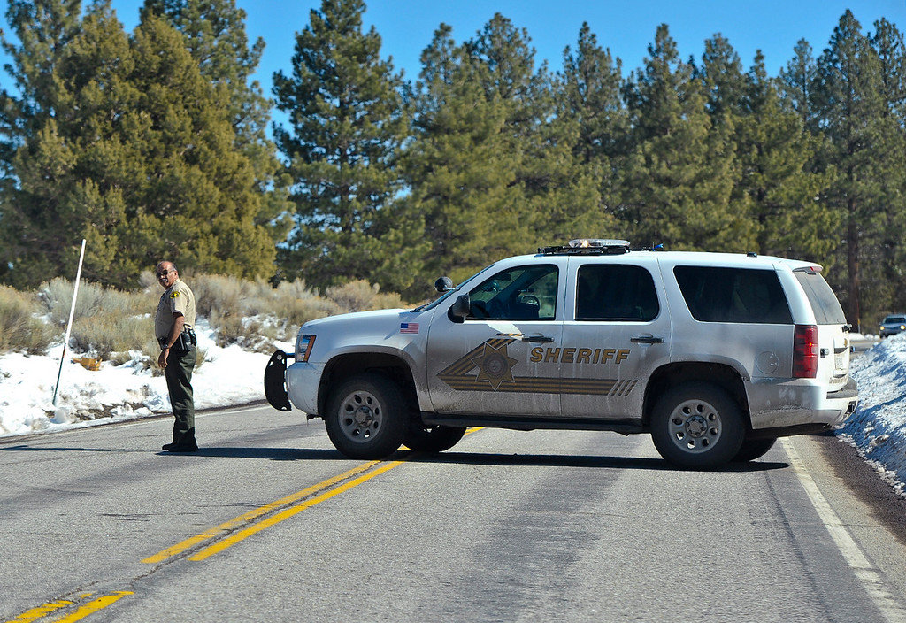 . A sheriff\'s deputy block Highway 38 where fugitive Christopher Dorner may have been sited near Highway 38 near Barton Flats in the San Bernardino Mountains on Tuesday, Feb. 12, 2013. (Rachel Luna / Staff Photographer)