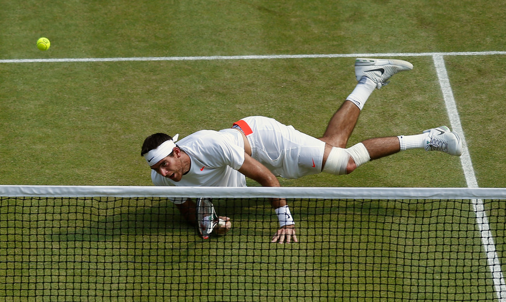 . Juan Martin Del Potro of Argentina eyes the ball as he plays a return to Novak Djokovic of Serbia during their Men\'s singles semifinal match at the All England Lawn Tennis Championships in Wimbledon, London, Friday, July 5, 2013. (AP Photo/Jonathan Brady, Pool)