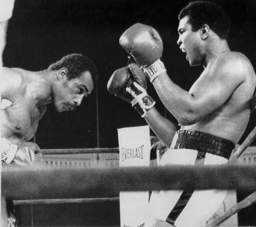 . His back against the ring ropes , Muhammad Ali continues to taunt Ken Norton during their heavyweight title bout 9/28/1976. Denver Post Library photo archive