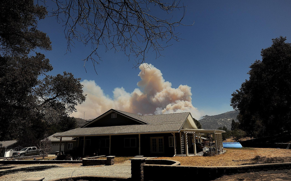 . The plume of the Silver Fire remains visible from the Goble residence along Twin Pines Road in the mountains south of Banning August 8, 2013.   GABRIEL LUIS ACOSTA/STAFF PHOTOGRAPHER.