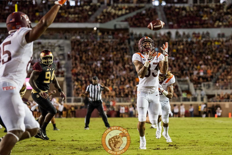 Eric Kumah (83) looks to catch a blocked punt attempt before returning it for a touchdown in the matchup between Virginia Tech and Florida State at Doak Campbell Stadium, Monday, Sept. 3, 2018. (Photo by Cory Hancock)