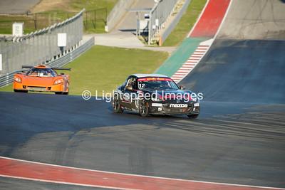 #12 Black / Gold Mazda MX5 Cup
