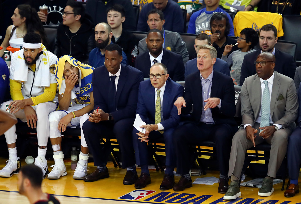 . Golden State Warriors head coach Steve Kerr, second from right, gestures from the bench during the second half of Game 1 of basketball\'s NBA Finals between the Warriors and the Cleveland Cavaliers in Oakland, Calif., Thursday, May 31, 2018. (AP Photo/Ben Margot)