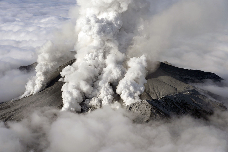 . Dense plumes are spewed out from Mount Ontake as the volcanic mountain erupts in central Japan Saturday, Sept. 27, 2014. The 3,067-meter (10,062-foot) peak erupted in spectacular fashion on Saturday, catching climbers by surprise and stranding dozens injured people in areas that rescue workers have been unable to reach. (AP Photo/Kyodo News)