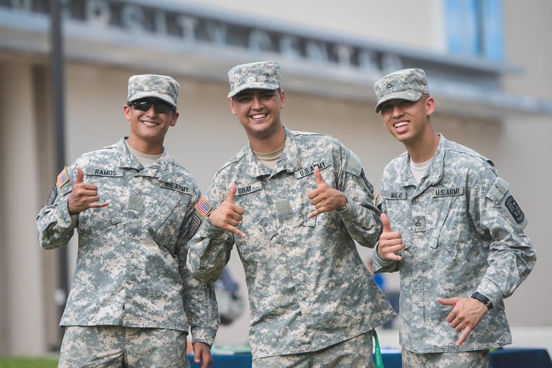 Emmanuel Ramos (left) David Gray and Stuart Malay pause for a photo during the ROTC recruitment event.