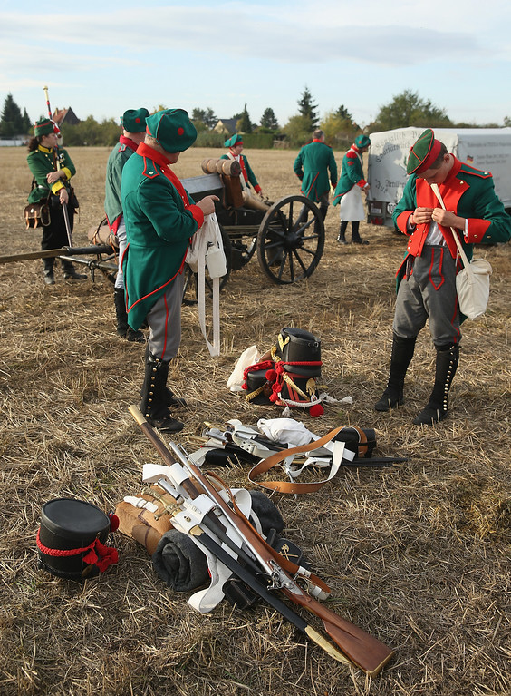 . Historical society enthusiasts in the role of Saxon artillery soldiers fighting under Napoleon arrive to re-enact The Battle of Nations on its 200th anniversary on October 20, 2013 near Leipzig, Germany. (Photo by Sean Gallup/Getty Images)