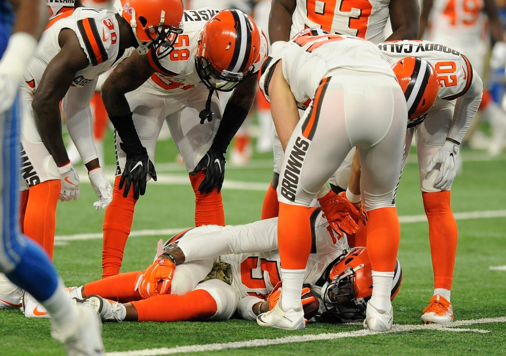 . Cleveland Browns outside linebacker Jamie Collins stays on the ground after a tackle by Detroit Lions offensive guard Graham Glasgow during the first half of an NFL football game, Sunday, Nov. 12, 2017, in Detroit. (AP Photo/Jose Juarez)