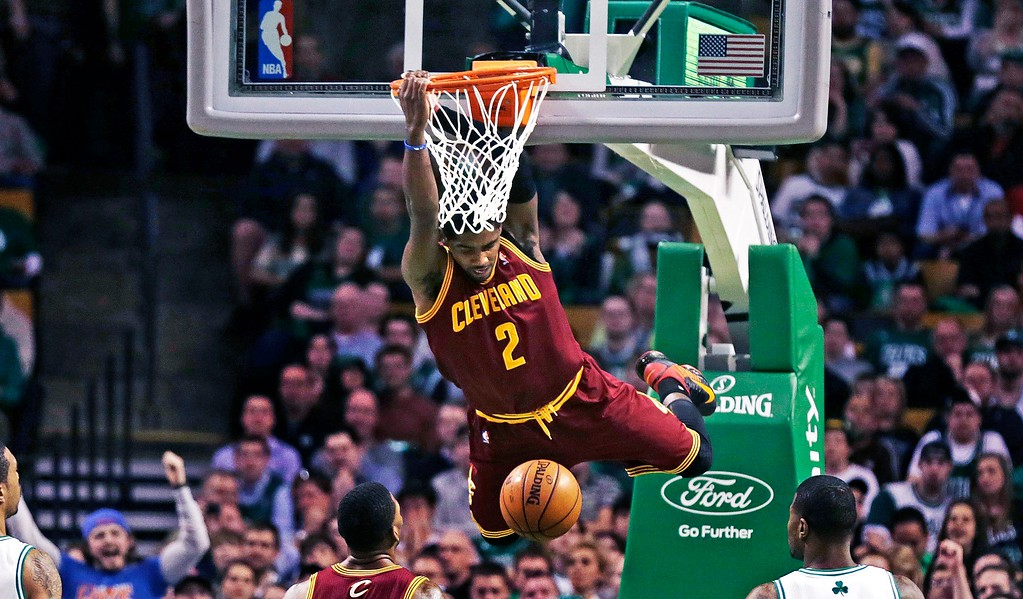 . Cleveland Cavaliers guard Kyrie Irving (2) dunks during the first quarter of an NBA basketball game against the Boston Celtics in Boston, Friday, April 5, 2013. (AP Photo/Charles Krupa)