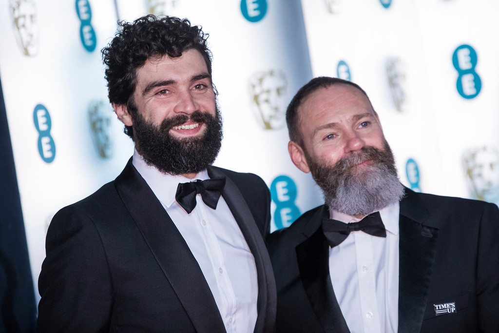 . Alec Secareanu and Francis Lee pose for photographers upon arrival at the BAFTA Film Awards after-party, in London, Sunday, Feb. 18, 2018. (Photo by Vianney Le Caer/Invision/AP)