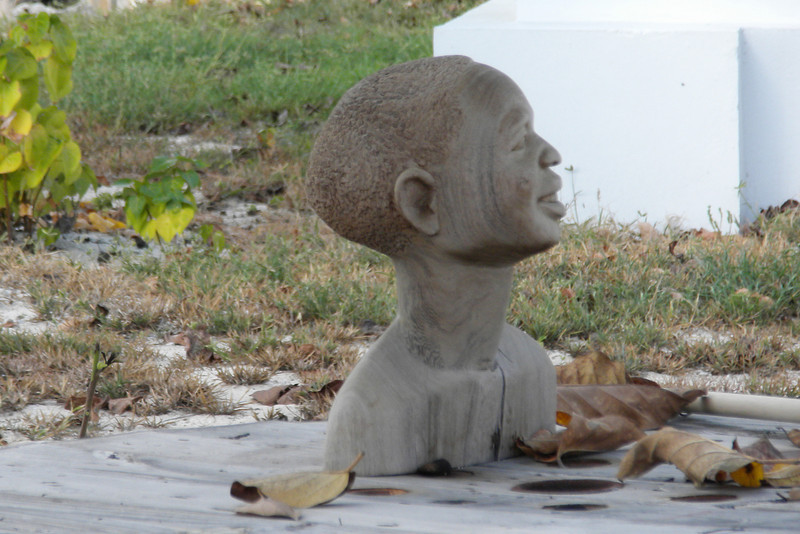 Local art displayed in back yard along Front Street in Grand Turk
