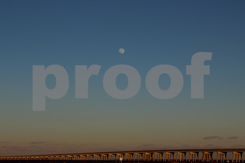 The Full Moon Watching Over The Bridge