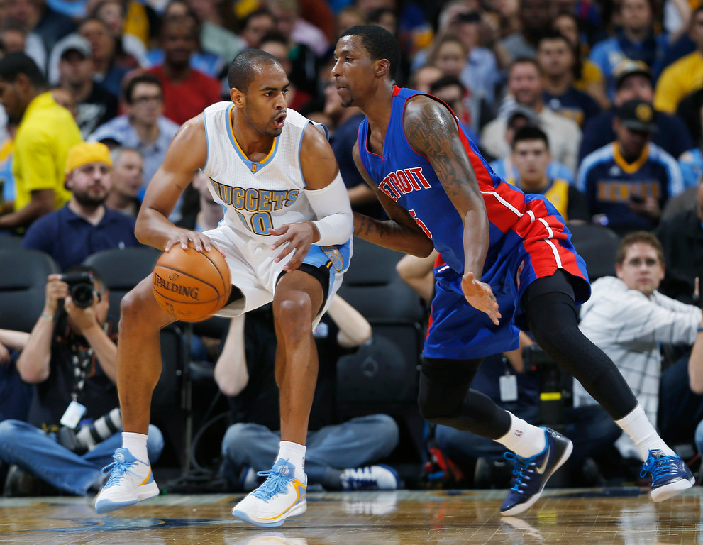 . Denver Nuggets guard Arron Afflalo, left, works the ball inside for shot as Detroit Pistons guard Kentavious Caldwell-Pope covers in the first quarter of an NBA basketball game in Denver on Wednesday, Oct. 29, 2014. (AP Photo/David Zalubowski)